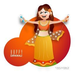 Beautiful young girl in traditional dress with firecracker for Indian Festival of Lights, Happy Diwali celebration.