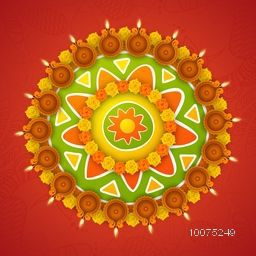 Colourful rangoli with flowers and illuminated oil lit lamps on floral decorated background for Indian Festival of Lights, Happy Diwali celebration.