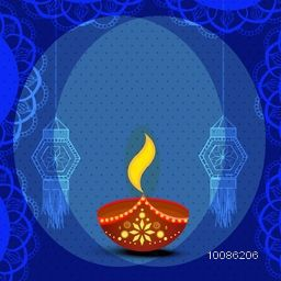 Elegant greeting card design with creative oil lamp on floral decorated blue background for Indian Festival of Lights, Happy Diwali celebration.