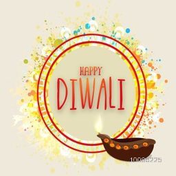 Elegant Greeting Card design with creative illuminated oil lamp (Diya) on colorful abstract background for Indian Festival of Lights, Happy Diwali celebration.