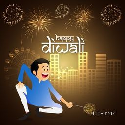 Happy boy playing with firecrackers on urban city view background for Indian Festival of Lights, Happy Diwali celebration.