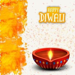 Elegant Greeting Card design with illuminated Oil Lamp (Diya), Creative abstract background with watercolor brush stroke for Indian Festival of Lights, Happy Diwali celebration.