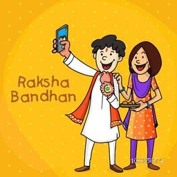 Happy brother and sister taking selfie with smartphone on yellow background for Indian festival, Raksha Bandhan celebration.