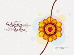 Beautiful rakhi design on stylish grey background for Indian festival of brother and sister love, Raksha Bandhan celebration.