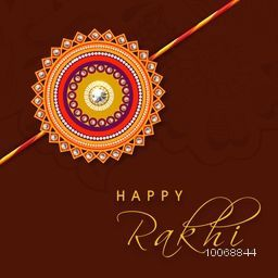 Beautiful floral rakhi on brown background for Indian festival of brother and sister love, Happy Raksha Bandhan celebration.