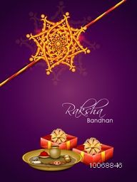 Beautiful golden rakhi with wrapped gifts and decorated plate on purple background for Indian festival of brother and sister love, Happy Raksha Bandhan celebration.