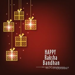 Golden hanging gifts on shiny background, Elegant greeting card design for Indian festival of brother and sister love, Happy Raksha Bandhan celebration.
