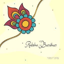 Beautiful floral design decorated rakhi on shiny yellow background for Indian festival, Raksha Bandhan celebration.