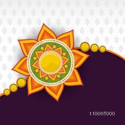 Beautiful floral design decorated rakhi on shiny grey and purple background for Indian festival, Raksha Bandhan celebration.