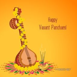Traditional musical instrument Veena with religious offerings on rangoli for Hindu Community festival, Vasant Panchami celebration.