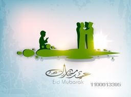 Arabic Islamic calligraphic text Eid Mubarak with silhouettes of Muslim peoples reading Namaj ( Islamic Prayer) and wishes each other. Concept for Muslim community holy festival Eid.