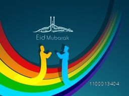 Arabic Islamic calligraphic of text Eid Mubarak with silhouettes of two Muslim people reading Namaj ( Islamic Prayer) on colorful wave background.
