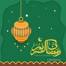 Arabic Islamic calligraphic of text Ramadan Kareem with beautiful hanging lantern on green background.
