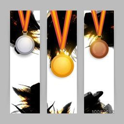 Creative Website Banner set with glossy Gold, Silver and Bronze Medals on abstract brush stroke background for Sports concept.