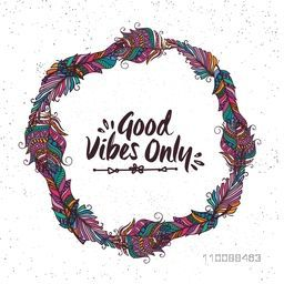Creative boho style frame made by colorful ethnic feathers with stylish text Good Vibes Only.
