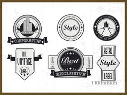 Set of vintage insignia, labels and business symbols on grungy background.
