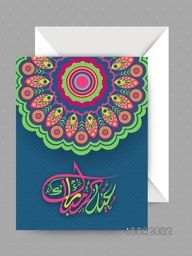 Elegant greeting card decorated with colourful traditional floral design and arabic islamic calligraphy of text eid mubarak for Muslim Community Festival celebration.