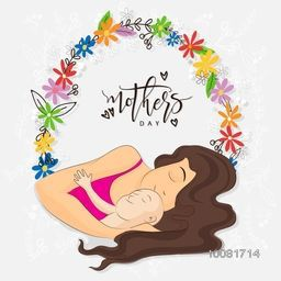 Young Mother laying with her cute little Baby on colorful flowers decorated background for Happy Mother's Day celebration.