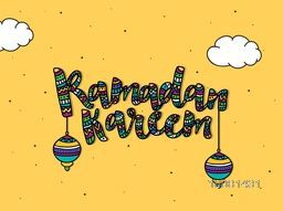 Colourful floral decorated text, Ramadan Kareem with hanging Lamps on yellow background, Elegant greeting card design for Muslim Community Festival celebration.