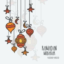 Elegant greeting card decorated with hanging Lamps, Moons and Stars for Islamic Holy Month, Ramadan Mubarak celebration.