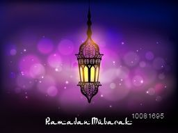 Beautiful traditional hanging Lamp on shiny background for Islamic Holy Month, Ramadan Mubarak celebration.