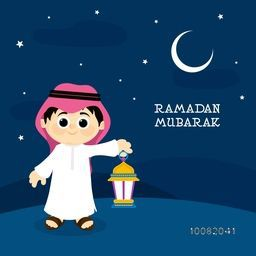Little Cute Islamic Boy in Traditional dress, holding Lantern on Desert, Night Background for Holy Month of Prayer, Ramadan Mubarak.