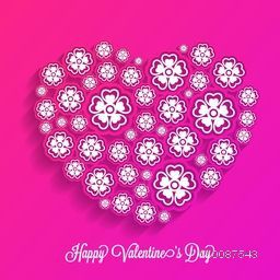 Creative Heart made by beautiful flowers on pink background for Happy Valentine's Day celebration.