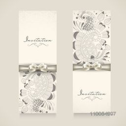 Set of two floral decorated invitation card in black and white binding with shiny silver ribbon with stylish text Invitation.