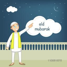 Cute Muslim boy in traditional dress pointing towards the moon on occasion of Islamic festival, Eid Mubarak celebration.