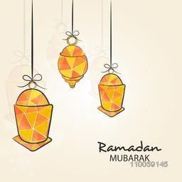 Colorful hanging arabic lamps or lanterns on beige background for holy month of muslim community, Ramadan Kareem celebration.