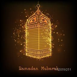 Beautiful golden lamp on shiny brown background for holy month of Muslim community Ramadan Kareem celebration.