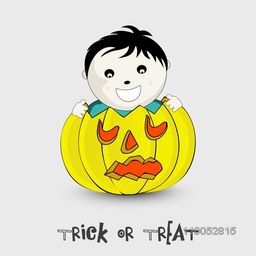 Smiling boy face with scary pumpkin for Halloween celebration and stylish Trick Or Treat Text on light grey background.