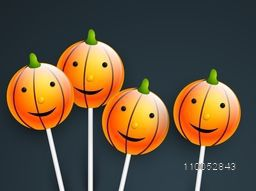 Smiling pumpkin face lollipop for Halloween party and day celebration.